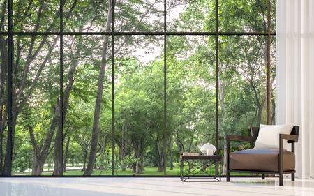Modern living room with garden view 3d rendering Image.There are large window overlooking the surrounding garden and nature Archivio Fotografico