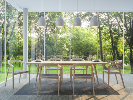 Modern dining room in the glass house 3d render image There are wooden floor there are large window overlooking to the garden and nature and finished with wood furniture