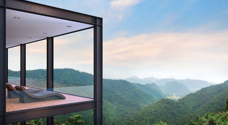 Modern steel structure house terrace with mountain view 3d rendering image. There are wood floor.Furnished with rattan daybed. There are glass railing overlooking the surrounding nature and mountain