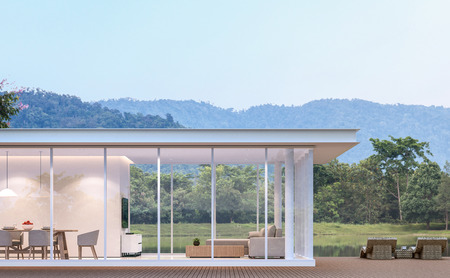 Modern white house with lake view 3d rendering image.there are white building with steel structure,wood terrace and nature view