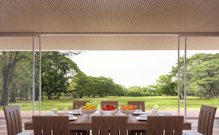 Modern contemporary dining room 3d rendering image.The Rooms have wooden lattice ceiling.furnished with wood furniture.There are large open doors. Overlooks wooden terrace and big garden.
