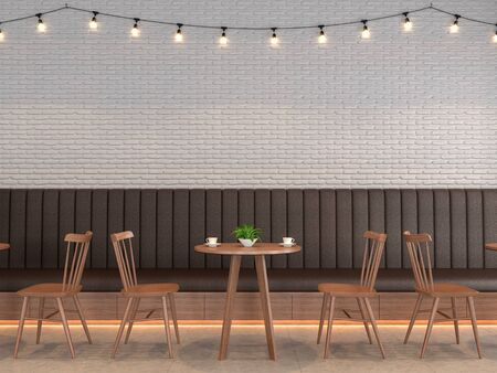 The coffee shop is designed in the loft style, with white brick walls decorated with brown leather benches and tables, wooden chairs adorning the walls with string lights. Фото со стока