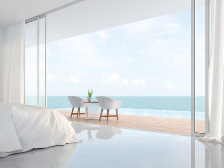Modern luxury white bedroom 3d render.There is a minimalistic building with white beds and chairs. There is a large open sliding door overlooking the infinity pool and sea view. Фото со стока