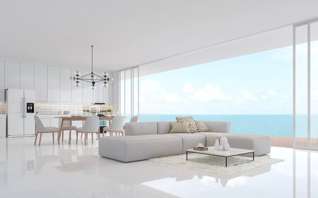 Luxury white living dining room with sea view 3d render.There is a minimalistic building interior with white fabric furniture. There is a large open sliding door overlooking the sea view. Фото со стока - 133803461