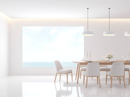 Minimal white dining room 3d render,Decorate with white fabric chair and simple wood table,There are large windows looking out to the sea. Фото со стока