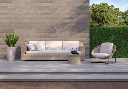 Loft style outdoor living area 3d render,There are wooden and concrete floor,rough concrete wall with wood plank stemped,green plant fence,decorate with ratten and fabric furniture.