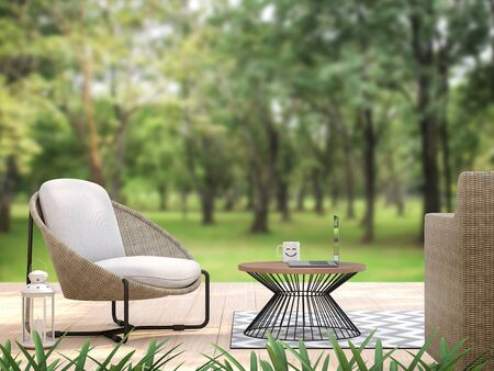 Outdoor terrace with blurry nature view blackground 3d render,There are wooden floor,decorate with rattan and fabric furniture,On the table, there is a laptop. It looks like working. Standard-Bild