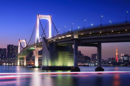 tokyo prefecture: Tokyo Rainbow Bridge with Tokyo Tower at sunset