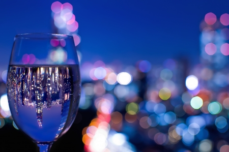 night life: Tokyo skyline reflected in a wine glass  Stock Photo