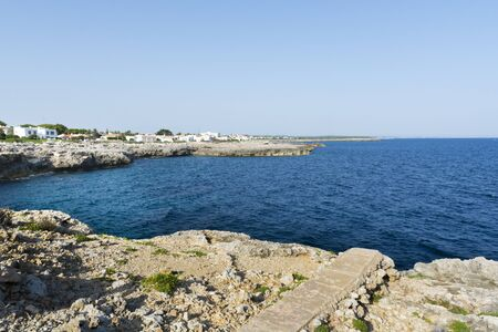 menorca: View of the rocky coast in Menorca in a summer day with blue sky and blue water, Menorca, Balearic Islands, Spain Stock Photo