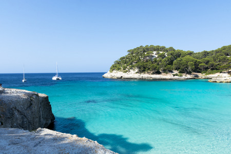 menorca: View of MacarellaView of Macarella bay in Menorca During a summer day with blue sky transparent water, Balearic Islands, Spain Stock Photo