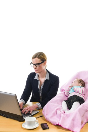 work life balance: Adult business woman wearing a costume and supplied her newborn daughter in the office workplace, isolated against a white background  Stock Photo