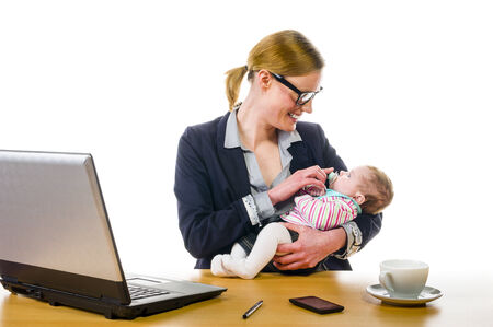 Adult business woman wearing a costume and supplied her newborn daughter in the office workplace, isolated against a white background  photo