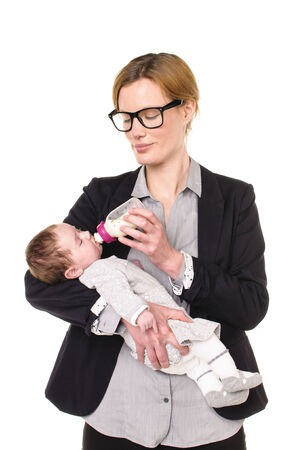 exempted female: Adult businesswoman Woman wearing shirt and jacket and has a baby in her arms which she gives the bottle, isolated against a white background