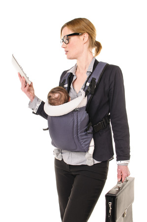exempted female: Adult business woman Woman wearing shirt and jacket and has an infant reads an email in a baby carrier while On Their Tablet PC, isolated against a white background