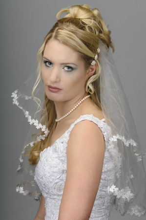 Portrait of a young bride with high hair and white bride dress. photo