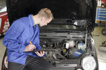 auto mechanic, mechatronic checked the engine compartment of a car in the garage