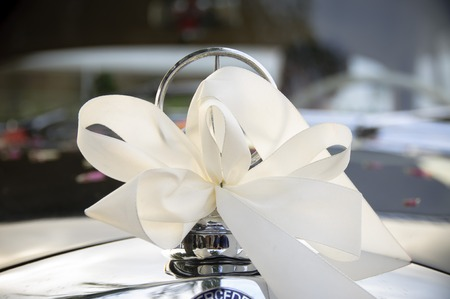 nuptial: Wedding Cars Khlerfigur is nuptial decorated with white bow Stock Photo