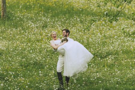 jackboots: Groom carrying his bride