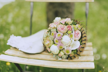 lawn chair: Still life of a wedding bouquet and bridal shoes on a lawn chair on a meadow outside