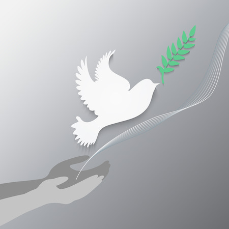 Dove with olive branch and hands.Concept of freedom and peace.