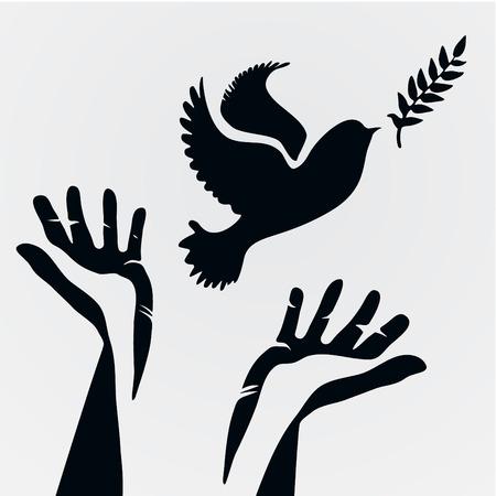 Paloma con la rama de olivo y hands.Concept de la libertad y la paz.