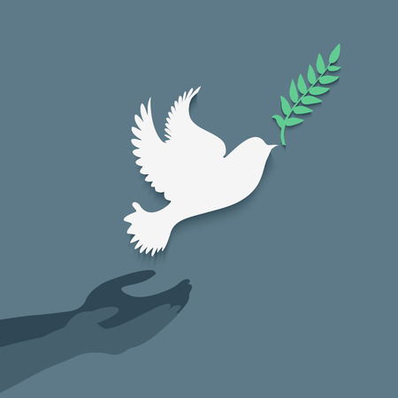 releasing: Dove with olive branch and hands.Concept of freedom and peace.