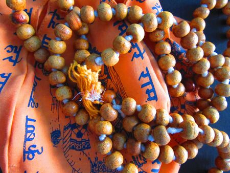 chand: GARLAND OR MALA BEING USED TO COUNT AND CHAND