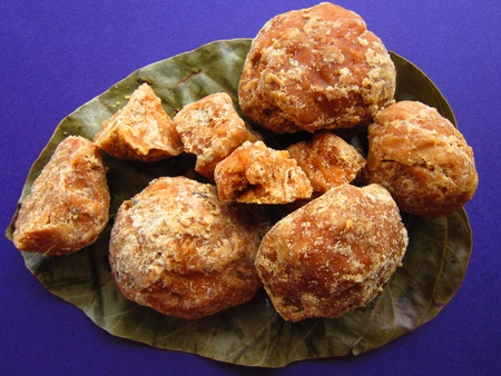 JAGGERY OR GUR IN BLUE BACKGROUND.