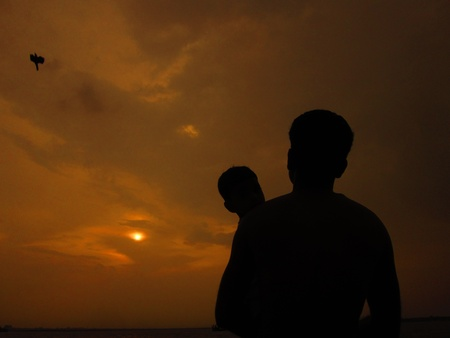 stupendous: father and son watching sunset
