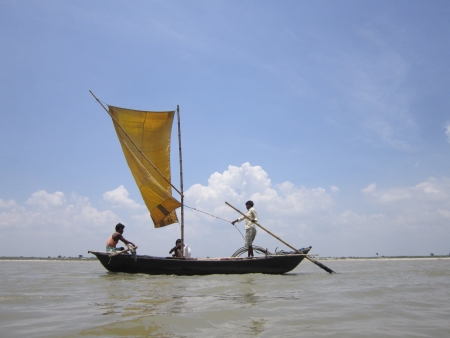 bihar: Countrymade boat sailing on river Ganges during pre-monsoon cloudy weather. Shot at Krishnaghat, Patna, Bihar at 12.15 PM on 07.07.12.
