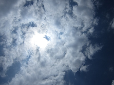 stupendous: BRIGHT SUN IN CLOUDY SKY. COVERED WITH CLOUD.