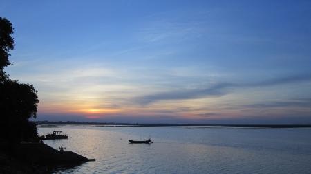 stupendous: Boat at amazing sunset on river ganges. Stock Photo