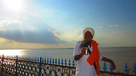 gurudwara: Sardar standing on bank of river Ganges at Gurdwara Handisaheb, Danapur, Shot during afternoon at Danapur, Bihar, Asia. Shot during afternoon at Danapur, Bihar, Asia. on 08,08,2012