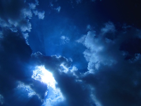 Amazing bright sun in blue cloudy sky