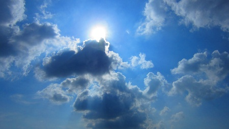 stupendous: Amazing bright sun in blue cloudy sky