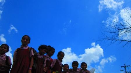 bodhgaya: Schoolgirl returning from school at Bodhgaya.Shot at 01.12 pm, on 10.08.12 at Bodhgaya, Bihar, India, Asia. Editorial