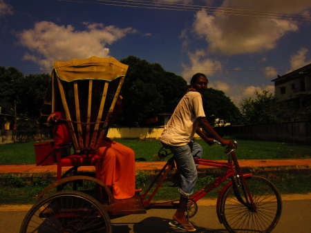 Monk travelling in local rickshaw at Bodhgaya. Shot at 0152 pm on 10.08.12 at Bodhgaya, Bihar, India, Asia.