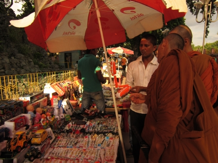 Monks purchasing table lamp at Mahabodhi temple complex, Bodhgaya. Shot at 1644 pm on 10.08.12 at Bodhgaya, Bihar, India, Asia.