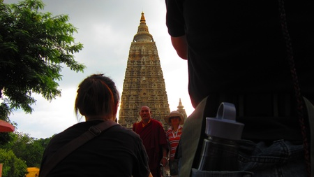 Travellers taking photo of Mahabhodi Temple, Bodhgaya. Shot at 1700 pm on 10.08.12 at Bodhgaya, Bihar, India, Asia.