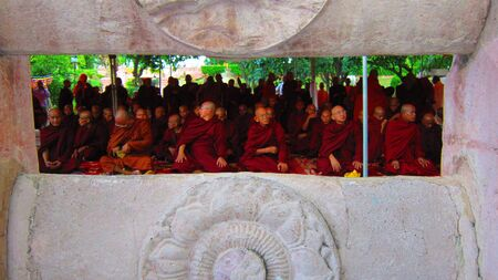 Monks getting ready for prayer at Mahabodhi temple, Bodggaya. Shot at 1705 pm on 10.08.12 at Bodhgaya, Bihar, India, Asia.