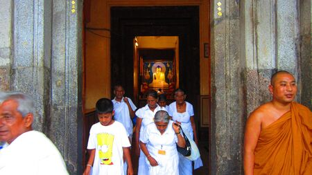 Pilgrims coming out of Mahabodhi temple, Bodhgaya. Shot at 1712 pm on 10.08.12 at Bodhgaya, Bihar, India, Asia.