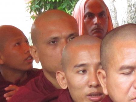 Monks praying at Mahabodhi temple, Bodhgaya. Shot at 1717 pm on 10.08.12 at Bodhgaya, Bihar, India, Asia. Stock Photo - 14816177