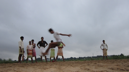 bodhgaya: Local Boys practicing high jump on the dry bed of river Niranjana, Bodhgaya. Shot at 0541 am on 11.08.12 at Bodhgaya, Bihar, India, Asia. Editorial