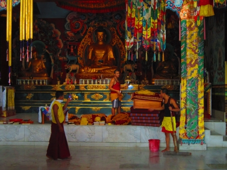 Monks cleaning a temple at Bodhgaya. Shot at 0923 am on 11.08.12 at Bodhgaya, Bihar, India, Asia.