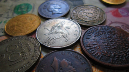 coins of different countries put together  Stock Photo