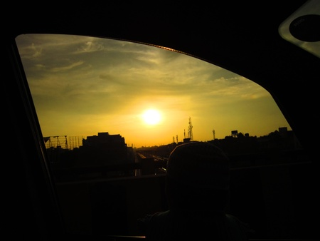stupendous: sun seen through frame of a car window Stock Photo