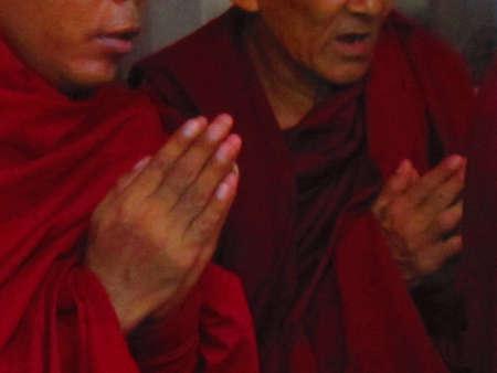 bodhgaya: PRAYER BY MONKS AT MAHABODHI TEMPLE WITH FOLDED HANDS.SHOT AT BODHGAYA , BIHAR, INDIA, ASIA AT 0519PM ON 10,08,12 Editorial