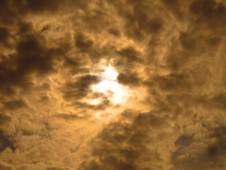stupendous: SUN COVERED BY ORANGE CLOUD