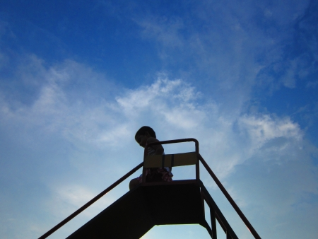 slack: kid coming down from a slide
